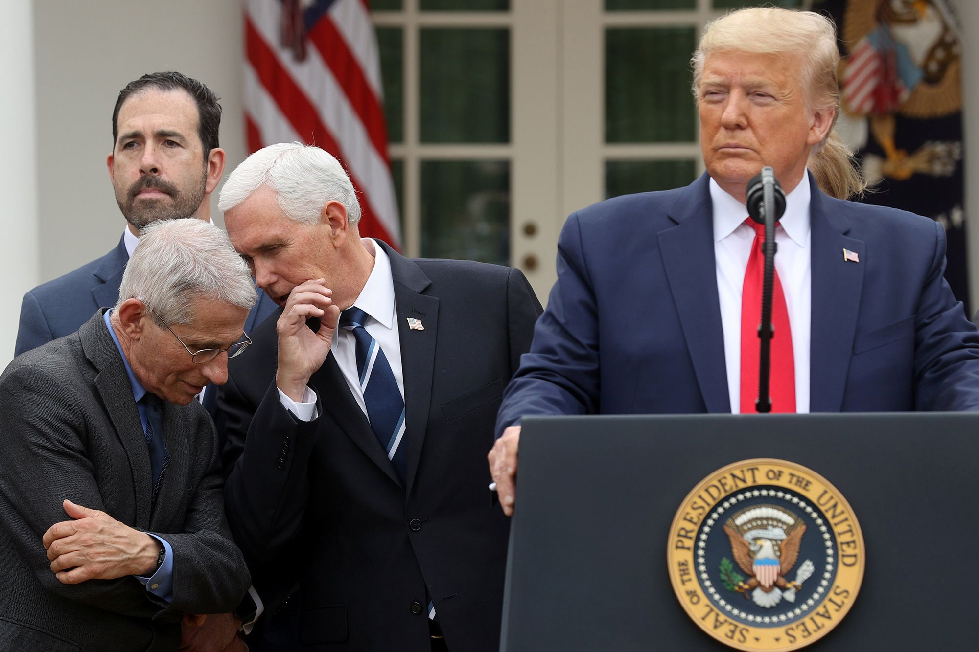 Vice President Mike Pence speaks with Anthony Fauci, director of the National Institutes of Allergy and Infectious Diseases, at the White House as President Donald Trump declared the coronavirus pandemic a national emergency.
